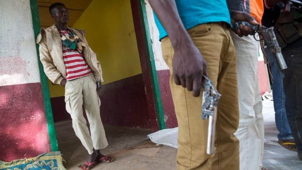 Members of the of the Anti-Balaka armed militia hold their weapons in the town of Bocaranga, Central African Republic, on April 28.  The predominantly Christian group has recently started using heavier weapons and more sophisticated military tactics, according to the UN.