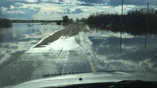 High water is flooding farmland and roads near Dixonville, Alta.