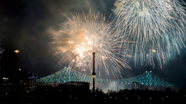 Fireworks explode over an illuminated Jacques Cartier Bridge in May to celebrate the city's 375th birthday.