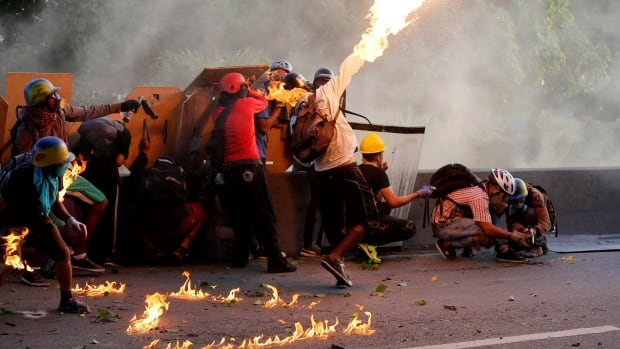 Scenes from the Venezuelan capital Caracas look like a war zone as the death toll rises in protests against the leader of the world's most oil-rich country.