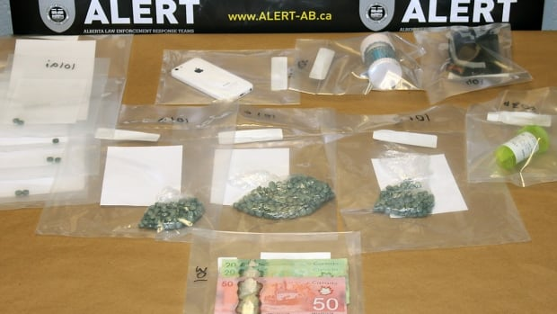 ALERT shows the items seized after searching an apartment in Lethbridge, Alta., including 400 fentanyl pills.