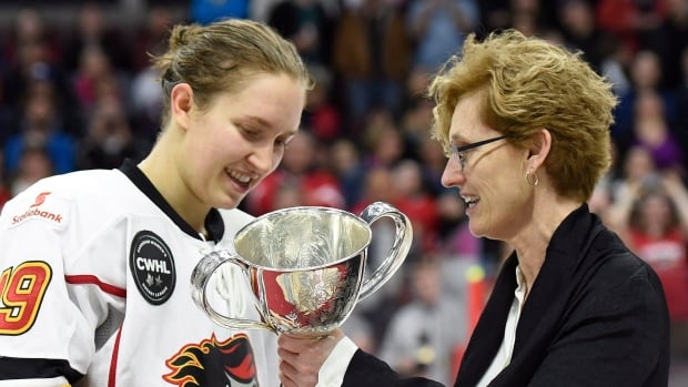 In this 2016 file photo, Canadian Women's Hockey League commissioner Brenda Andress presents Calgary Inferno captain Brianne Jenner with the Clarkson Cup.
