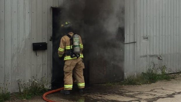Firefighters arrived at a commercial building on County Road 42 around 2:30 p.m. and found thick smoke pouring out the the grey metal building.