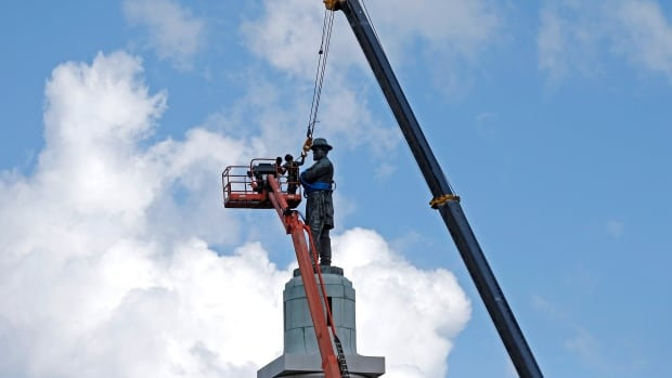 Erected in 1884, Confederate general Robert E. Lee's statue in New Orleans was removed Friday in accordance with a 2015 City Council vote.