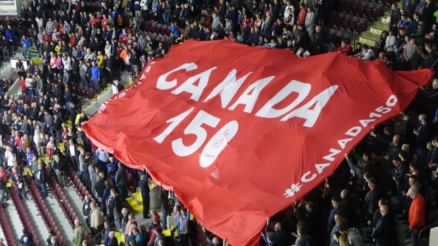 Fans pass along a massive Canada 150 flag before the Windsor Spitfires take on the Saint John Sea Dogs on May 19.