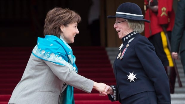 British Columbia Premier Christy Clark greets Lt.-Gov. Judith Guichon prior to the delivery of the 2015 speech from the throne inside the legislature in Victoria, B.C.