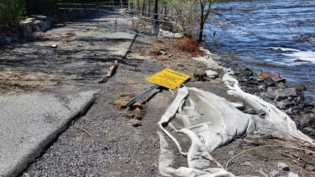 Knocked over sign and barricade washed out NCC path May 19, 2017