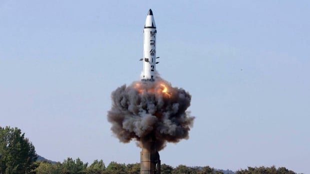 In this undated photo distributed by the North Korean government, a solid-fuel Pukguksong-2 missile lifts off during its launch test at an undisclosed location in North Korea. The missile flew about 500 kilometres and reached a height of 560 kilometres on Sunday.