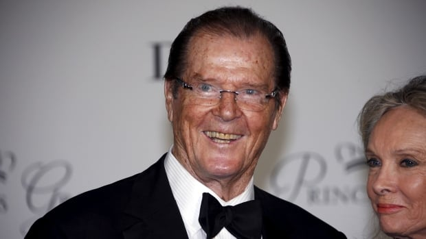 British actor Roger Moore and his wife, Kristina Tholstrup, are shown at a gala event in Monaco on Sept. 5, 2015. Moore, who played 007 in seven James Bond films, has died at 89 following a battle with cancer, according to his official Twitter account.