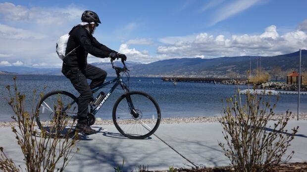 Penticton B.C. cyclist at lake