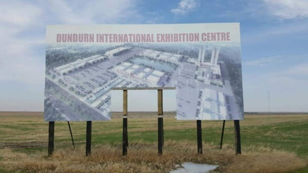 A sign announcing the Dundurn project sits in an empty field in May 2017.