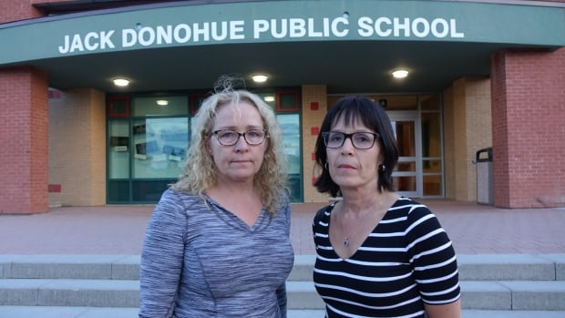 Teachers Tracey Haley and Cindy Wynter-Francis both worked outside at Jack Donohue Elementary School on Tuesday after finding out about high levels of radon detected at the school.