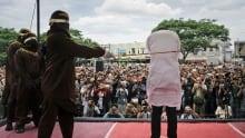APTOPIX Indonesia Gay Couple Caned