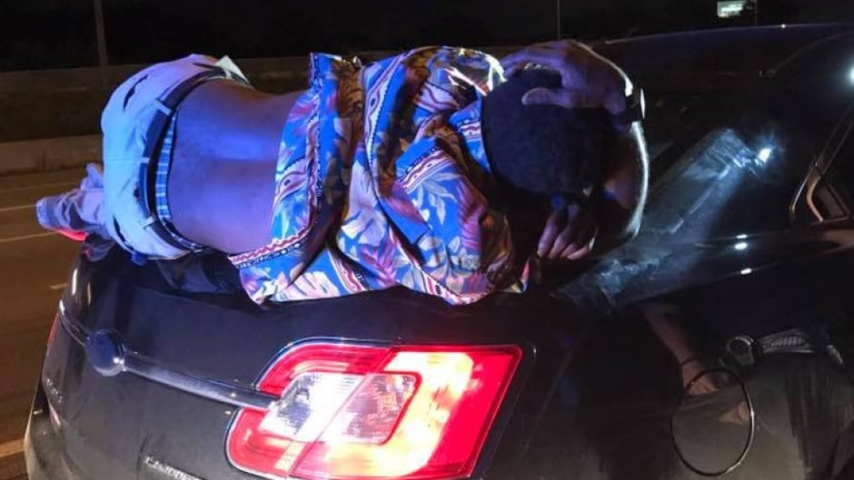 No Joke: Unconscious man rode on car's trunk for miles