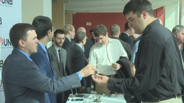 Engineering students showcase metal 3D printed components at the launch announcement of the Marine Additive Manufacturing Centre of Excellence at the University of New Brunswick.