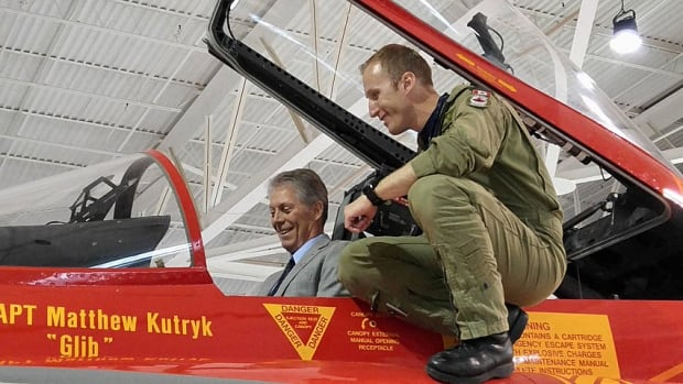 Mayor Fred Eisenberger sat in the cockpit of the Canada 150 fighter jet alongside Matthew Kutryk at the Canadian Warplane Heritage Museum in Ancaster on Thursday.