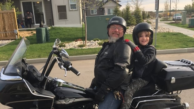 Seven-year-old Xander Hartson and 52-year-old Steve Enns
