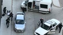 Police arrested 2 men after executing a drug warrant Friday.