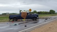 Debris covered Highway 59 just south of Winnipeg on Sunday morning and a blue truck sat facing the w