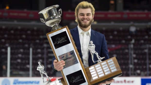 CHL Player of the Year Award recipient Alex DeBrincat, from the Erie Otters, holds his trophy following a media availability at the Memorial Cup Saturday in Windsor. Windsor will face the Erie Otters in the final of the Memorial Cup.