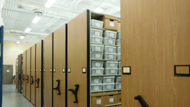 View of the interior of the archeology lab showing part of the archeological collection in storage. The collection is comprised of over 1 million artifacts from Atlantic Canadian archeological sites, and is a unique resource for researchers, students, and members of descendant communities whose stories are recorded in these objects.