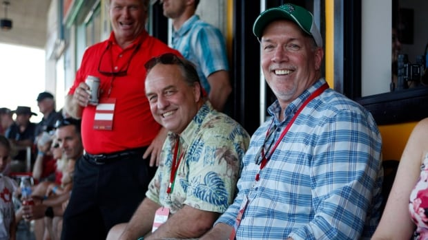 Green party leader Andrew Weaver and NDP leader John Horgan take in the final match between Team Canada and New Zealand at the HSBC Canada Women's Sevens on Sunday.