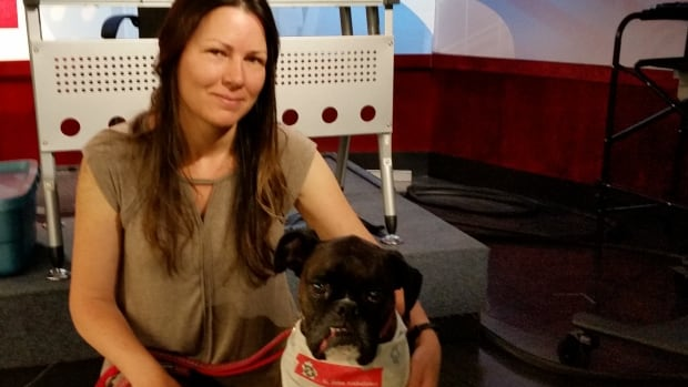 U of S researcher Colleen Dell and therapy dog Soobie have a long history together helping others.