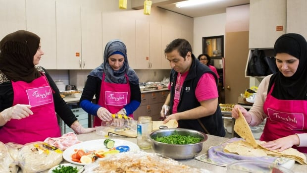 Women of Tayybeh and their families help prepare a pop-up dinner. The group provides catering as well as near-monthly pop-up dinners at roving locations.