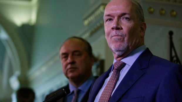 B.C. Green Party Leader Andrew Weaver and NDP Leader John Horgan speak to media on Monday after announcing they'll be working together to help form a minority government.