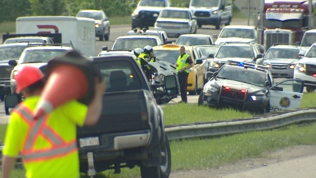 Paramedics, officer hurt by combative patient at scene of four vehicle collision