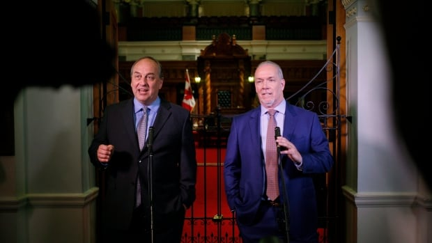 B.C. Green Party Leader Andrew Weaver and B.C. NDP Leader John Horgan speak to media after announcing they'll be working together to help form a minority government during a press conference at the B.C. Legislature in Victoria, on May 29, 2017.