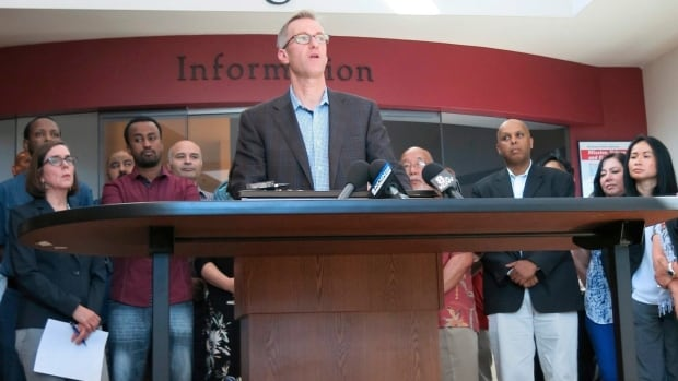 """Portland Mayor Ted Wheeler speaks at a news conference after a man fatally stabbed two men Friday when they tried to stop him from yelling anti-Muslim slurs.  Wheeler on Monday urged U.S. officials and organizers to cancel a """"Trump Free Speech Rally."""""""
