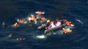 Refugees in Mediterranean Sea leap off burning boat