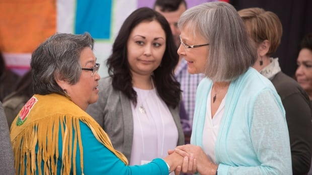 Frances Neumann is greeted by Chief Commissioner Marion Buller as the National Inquiry into Missing and Murdered Indigenous Women and Girls got underway in Whitehorse, under a tent on the banks of the Yukon River.