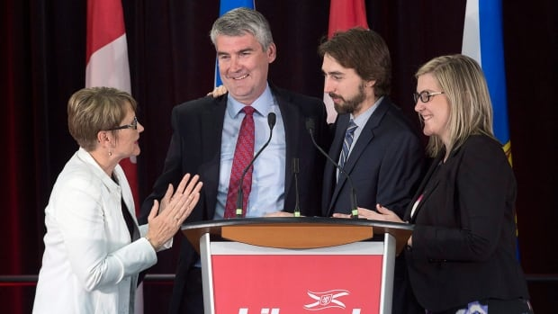 Nova Scotia Premier Stephen McNeil is embraced by his wife Andrea, daughter Colleen and son Jeffrey as he addresses the crowd at his election night celebration in Bridgetown.