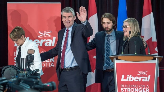 Nova Scotia Premier Stephen McNeil waves as he heads from the stage with his wife, Andrea, daughter Colleen and son Jeffrey after addressing supporters at his election night celebration in Bridgetown.