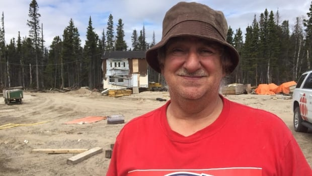 John Chaisson may be smiling, but he's not happy about how the overflowing Churchill River damaged homes in Mud Lake and Happy Valley-Goose Bay.