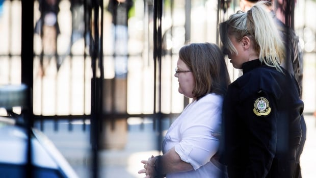 Elizabeth Wettlaufer is escorted into the courthouse in Woodstock, Ont., on Thursday. The former nurse has pleaded guilty to killing eight patients under her care, making her Canada's first convicted health-care killer.
