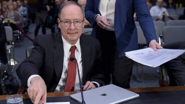 Former National Security Agency director Keith Alexander, seen here testifying before the U.S. Senate intelligence committee in March, says Canada may need to develop an offensive cyber security posture or the ability to shut down cyberattacks.