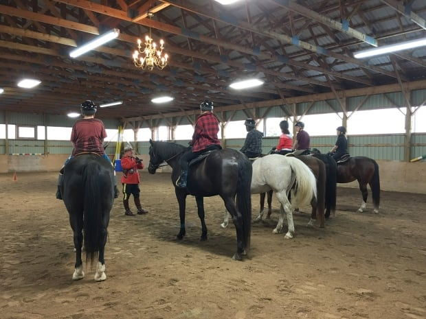 RCMP Constable Terry Russell provides horse training to at-risk youths