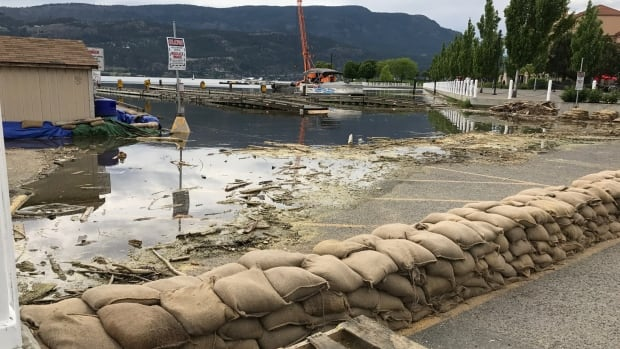 Lake Okanagan has already risen over the boat loading area and into the parking lot near downtown Kelowna.