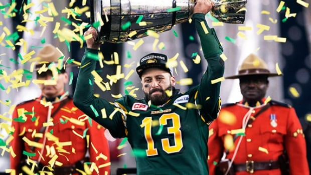 Edmonton Eskimos quarterback Mike Reilly hoists the Grey Cup after his teams win over the Ottawa in 2015.