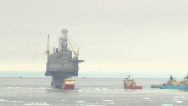 Several vessels were attached to the Hebron platform, as it began its journey offshore on Saturday afternoon.