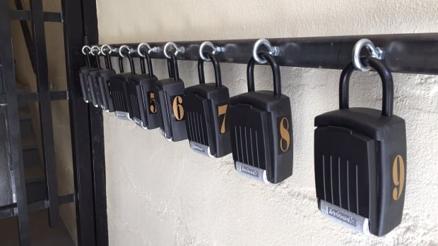 Key lock boxes at a Kensington Market apartment building that residents say has been converted almost exclusively to Airbnb listings.