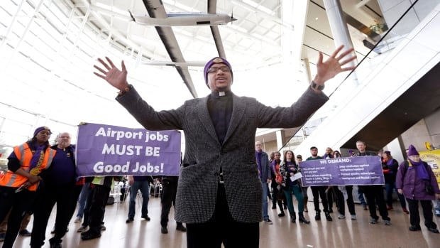 Pastor John Stean leads a prayer for workers after a demonstration in favour of a minimum wage of $15 an hour at Seattle-Tacoma International Airport last November.