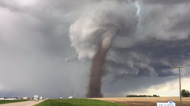 A tornado spotted near Three Hills, Alta., was moving east at 50 km/h. Emergency officials have cancelled the warning for Kneehill County and Starland County.
