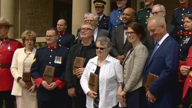 Justice Award winners: (front row) Lindsay Daniller of REACH Edmonton; Staff Sgt. Frank Cattoni with SORCe; Dr. Andre P. Grace representing Comprehensive Health Education Workers Project; Beverly Salomons with Alberta Citizens on Patrol Association; Jessica Hutton for Camrose Open Door Association; and Assistant Chief Judge James Ogle of the Calgary Drug Treatment Court.