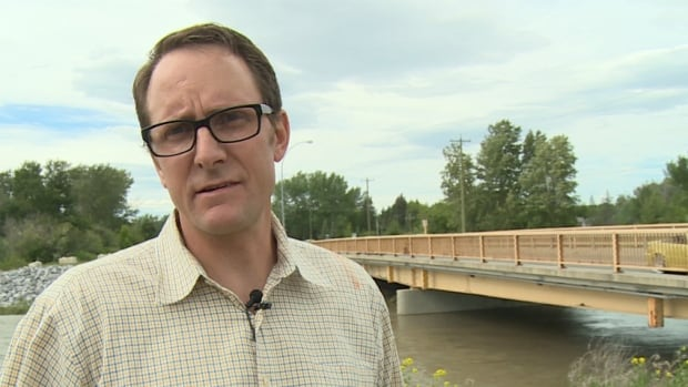 High River Mayor Craig Snodgrass, pictured in front of the Centre Street bridge, says the whole town will eventually be bermed, making it one of the most well-protected communities in the country.