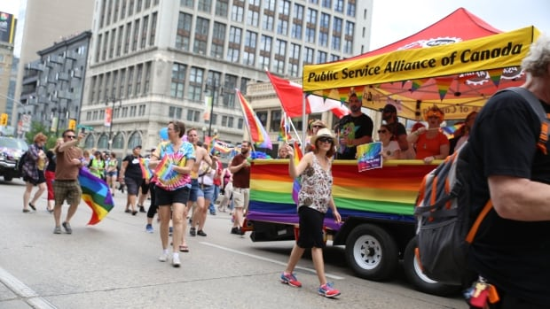 Winnipeg's 30th Pride parade took place Sunday. This year, police were asked not to wear their uniforms in the march.