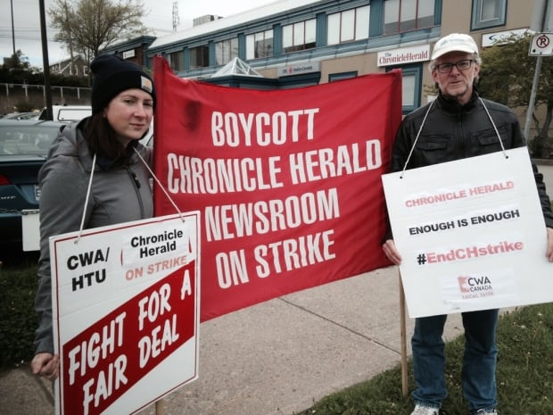 Striking Chronicle Herald reporters Erin Pottie, Tom Ayers